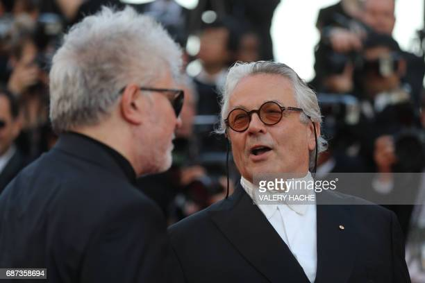 Spanish director Pedro Almodovar and Australian director George Miller arrive on May 23 2017 for the '70th Anniversary' ceremony of the Cannes Film...