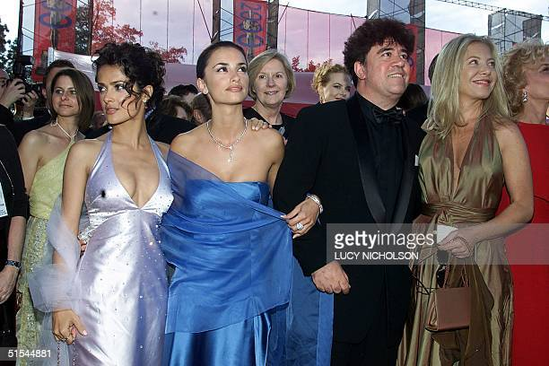 Spanish director Pedro Almodovar arrives with actresses Salma Hayek Penelope Cruz of Spain and Cecilia Roth of Argentina at the Shrine Auditorium for...