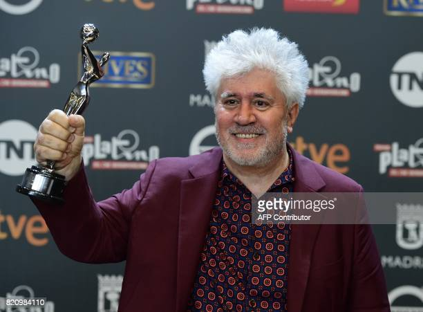 Spanish director Pedro Almodovar displays his trophy for Best Direction during the 4th edition of the 'Premios Platino' for IberoAmerican Cinema...