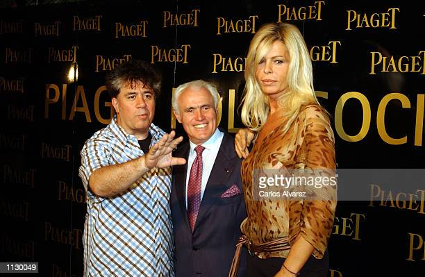 Spanish director Pedro Almodovar Jean Piaget and actress Biby Andresen attend a party for the new Piaget Swiss watch Polo Society July 2 2002 in...