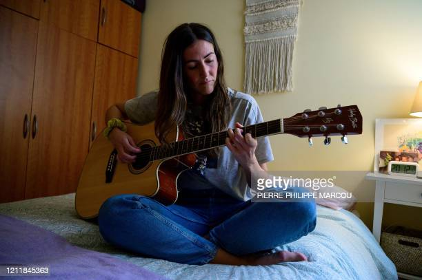 Spanish doctor Cristina Rios plays guitar in her room in Madrid on May 4 2020 Not far from the Madrid hospital where they brave the coronavirus in...