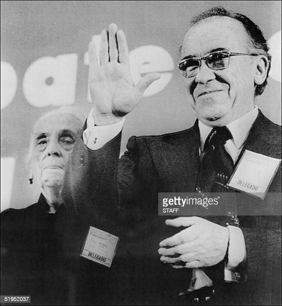 Spanish Dolores Ibarruri known as la Pasionaria stands beside Communist Party GeneralSecretary Santiago Carrillo during first day meeting 19 April...