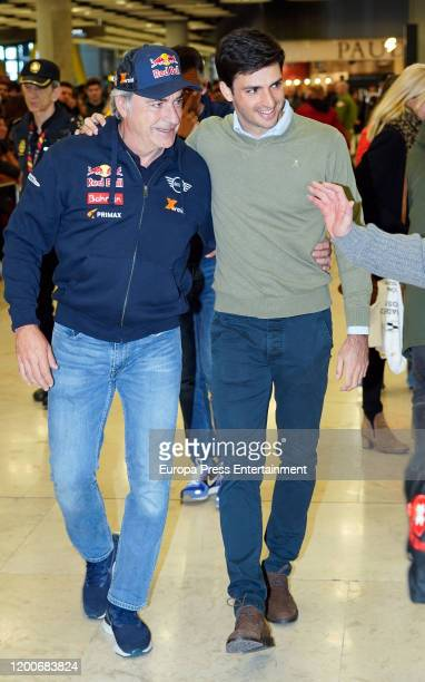 Spanish driver Carlos Sainz is greeted by his son Carlos Sainz Jr upon his arrival at the Adolfo Suarez Barajas Airport after he won his third Dakar...