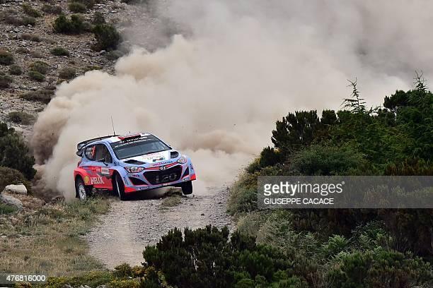 Spanish driver Dani Sordo and codriver Marc Marti steer their Hyundai I20 WRC during the 2015 FIA World Rally Championship in Sardegna on June 12...