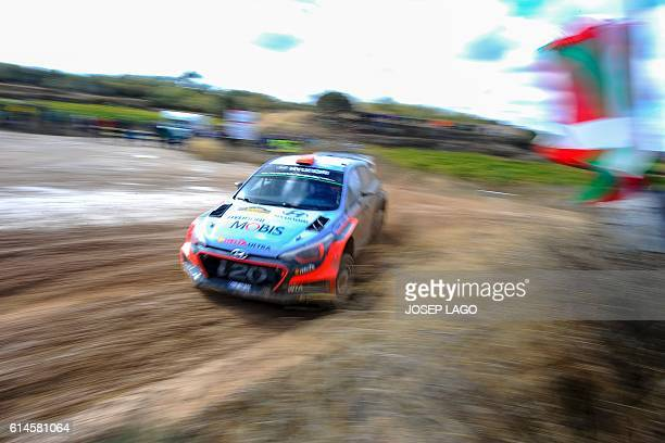 Spanish driver Daniel Sordo and codriver Marc Marti steer their Hyundai NG i20 WRC as they compete during the second day of the 52nd Rally de...