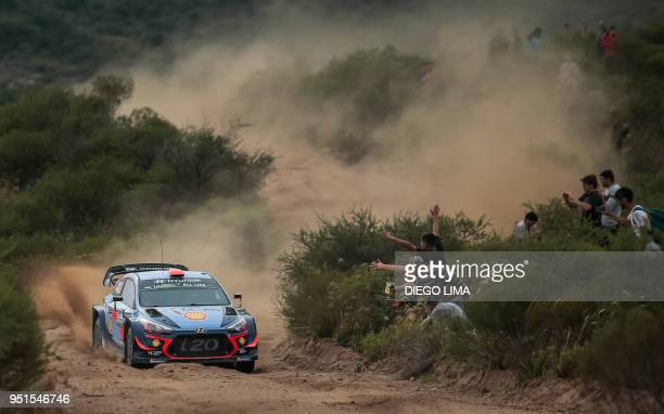 TOPSHOT Spanish driver Daniel Sordo steers his Hyundai i20 Coupe WRC with his compatriot codriver Carlos Del Barrio during the shakedown of the WRC...