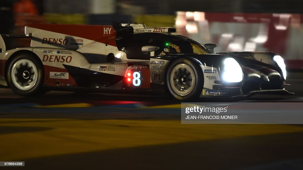 TOPSHOT - Spanish driver Fernando Alonso competes in his Toyota TS050 Hybrid LMP1 during the 86th Le Mans 24-hours endurance race, at the Circuit de la Sarthe on June 17, 2018 in Le Mans, western France.