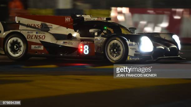 TOPSHOT Spanish driver Fernando Alonso competes in his Toyota TS050 Hybrid LMP1 during the 86th Le Mans 24hours endurance race at the Circuit de la...