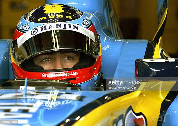 Spanish driver Fernando Alonso of Team Renault waits in his car in the pits during the free practice at the Grand Prix of Canada at the Circuit Gille...