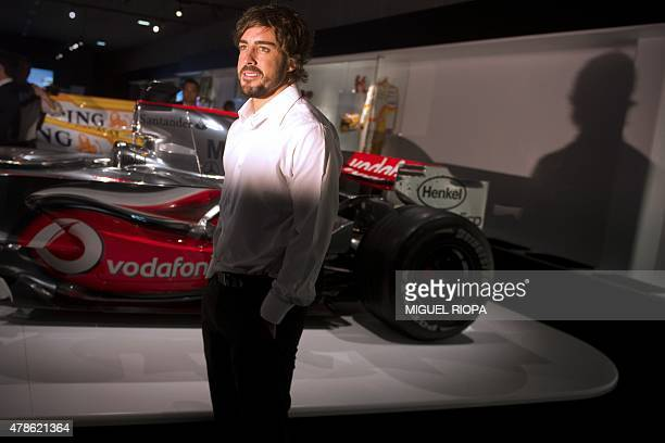 F1 Spanish Driver Fernando Alonso Poses Next To A F1 Car During The