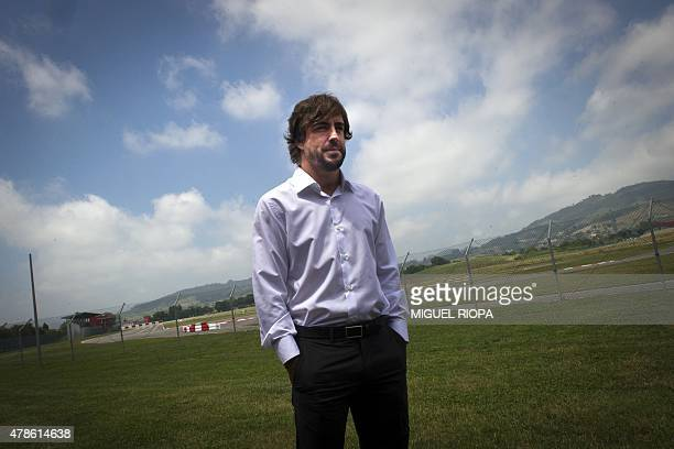 F1 Spanish driver Fernando Alonso poses next to his new complex's karting circuit during the opening of his Museum and Foundation in Llanera northern...