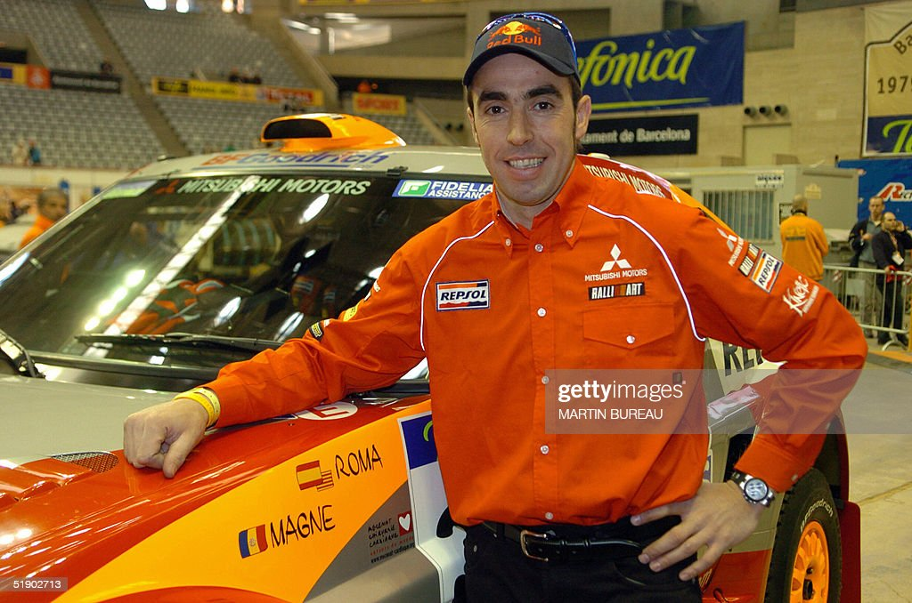 Spanish Driver Nani Roma Poses Next To His Car In The Inspection