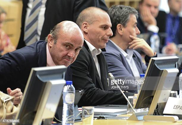 Spanish Economy minister Cristobal Montoro Romero and Greek Finance Minister Yanis Varoufakis attend a Eurogroup Council meeting on June 24 2015 at...