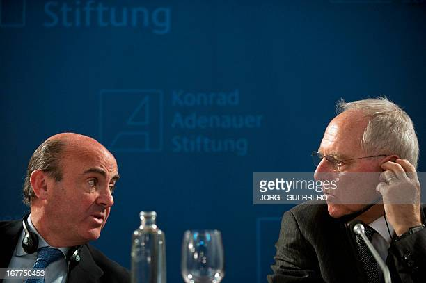 Spanish Economy Minister Luis de Guindos and German Finance Minister Wolfgang Schaeuble give a press conference after their bilateral meeting in...