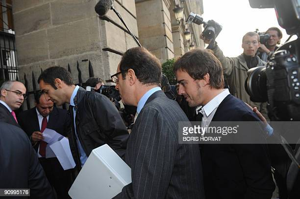 Spanish F1 driver Fernando Alonso arrives at FIA headquarters in Paris on September 21 2009 following Renault F1 team lawyer Andrew Ford for an...
