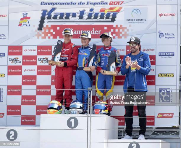 Part of this image has been pixellated to obscure the identity of the child Spanish F1 driver Fernando Alonso attends the Spanish Kart Racing at...