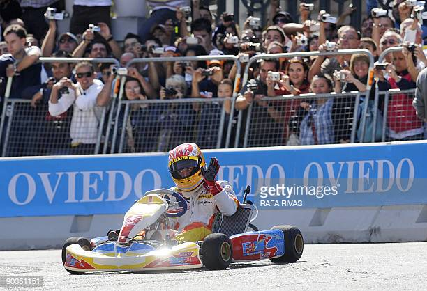Spanish F1 driver Fernando Alonso drives a kart as during a Renault Road Show celebrated in his home town of Oviedo northern Spain on September 05...