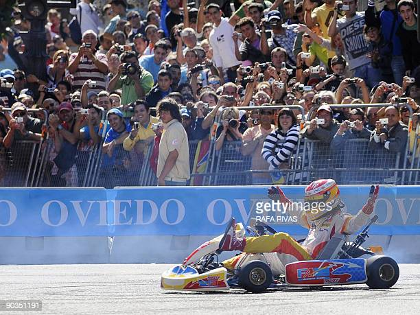 Spanish F1 driver Fernando Alonso drives a kart during a Renault Road Show celebrated in his home town of Oviedo northern Spain on September 05 2009...