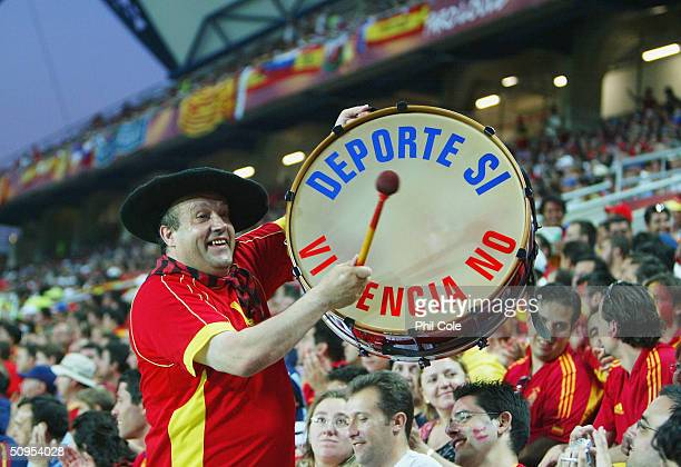 Spanish fan plays his drum during the Spain v Russia Group A match in the 2004 UEFA European Football Championships at the Estadio Algarve on June 12...