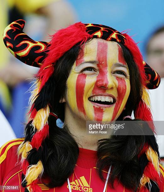 Spanish fan with her face painted in her country's colours smiles prior to the FIFA World Cup Germany 2006 Group H match between Spain and Ukraine...