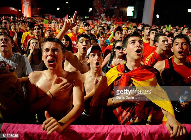 Spanish fans celebrate after Spain beat Russia 30 while watching Spain on a giant tv screen the Euro 2008 semifinal match between Spain and Russia at...