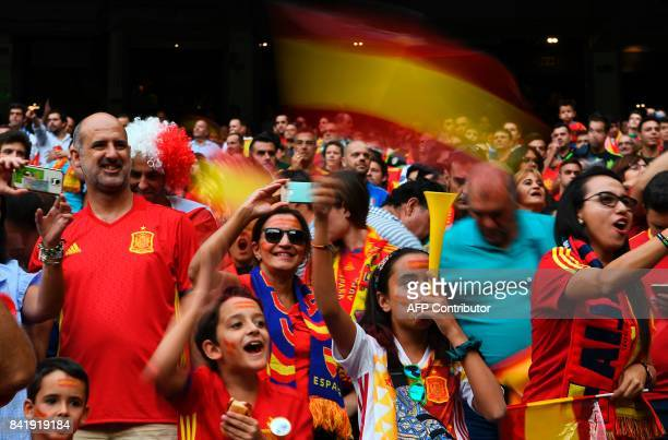 Spanish fans gesture before the World Cup 2018 qualifier football match Spain vs Italy at the Santiago Bernabeu stadium in Madrid on September 2 2017...