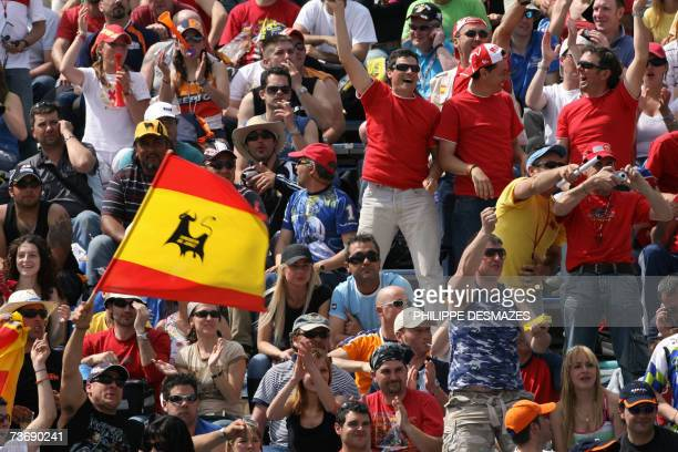 Spanish fans reacts after the fastest lap of the Spanish motor GP rider Dani Pedrosa in Jerez 24 March 2007 at the end of the qualifying practice for...