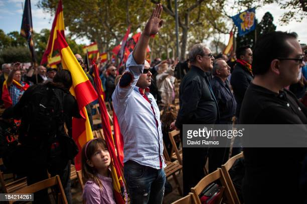 Spanish far right member does a Nazi salute as he demonstrates against the independence of Catalonia during the Spain's National Day on October 12...