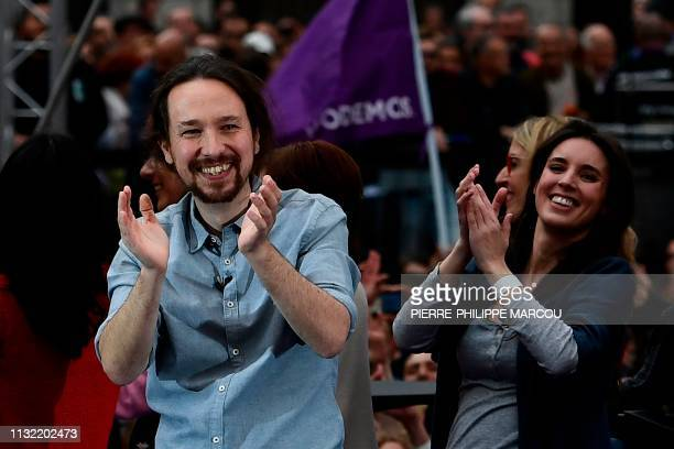 Spanish farleft Podemos party leader Pablo Iglesias and Podemos MP Irene Montero attend a precampaign rally in Madrid on March 23 2019 ahead of...
