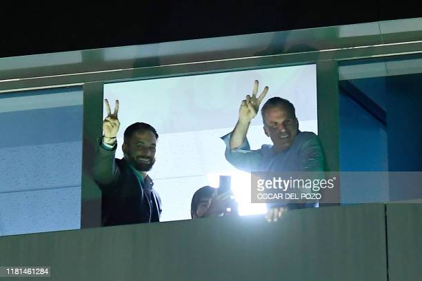 Spanish farright party Vox candidate for prime minister Santiago Abascal and Vox spokesman in the Madrid's city hall Javier Ortega Smith sign a V for...