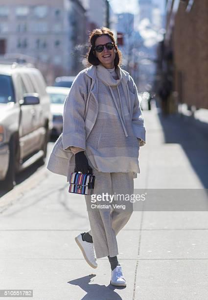 Spanish fashion blogger Gala Gonzalez is wearing a creme wool coat and grey gloves seen outside Derek Lam during New York Fashion Week Women's...
