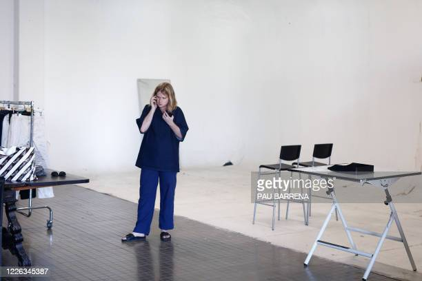 Spanish fashion designer Archie AlledMartinez uses his mobile phone during a fitting session ahead of the Paris Fashion Week on June 30 2020 in...
