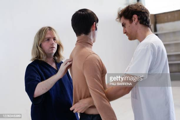 Spanish fashion designer Archie AlledMartinez works during a fitting session ahead of the Paris Fashion Week on June 30 2020 in Barcelona