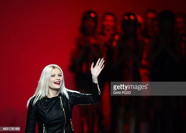 Spanish fashion designer Maya Hansen waves from the catwalk during the Autumn-Winter 2015-2016 collection fashion show at Madrid Fashion Week on...