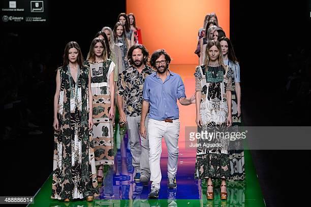 Spanish fashion designers Aitor Munoz and Inaki Munoz salute on the runway at the Ailanto show during MercedesBenz Fashion Week Madrid Spring/Summer...