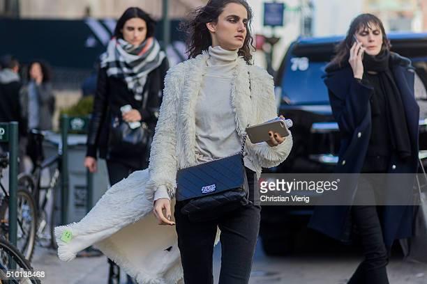 Spanish fashion model Blanca Padilla wearing a black Chanel bag and long creme fluffy fur coat and a creme turtleneck seen outside Tadashi Shoji...