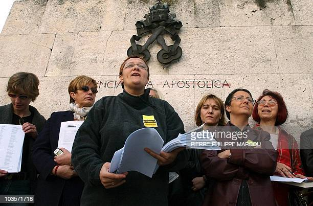 Spanish feminists carry copies of document with 26000 signatures to the Vatican delegation headquarters in Madrid 05 March 2003 The protest was...