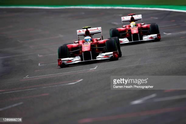 Spanish Ferrari Formula One racing driver Fernando Alonso driving his Ferrari F10 racing car ahead of his Brazilian team mate Felipe Massa during...