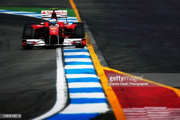 Spanish Ferrari Formula One racing driver Fernando Alonso driving his Ferrari F10 racing car during practice for the 2010 German Grand Prix,...