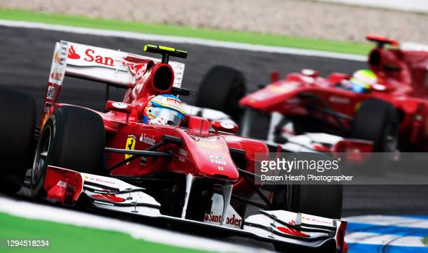 Spanish Ferrari Formula One racing driver Fernando Alonso driving his Ferrari F10 racing car ahead of his team mate Brazilian Felipe Massa in first...