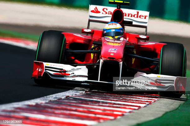 Spanish Ferrari Formula One racing driver Fernando Alonso driving his Ferrari F10 racing car during practice for the 2010 Hungarian Grand Prix,...