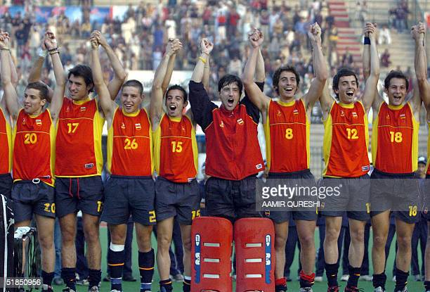Spanish field hockey players celebrate victory in the men's Champions Trophy field hockey tournament at the National Hockey Stadium in Lahore 12...