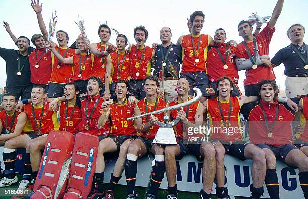 Spanish field hockey team players pose with winning trophy of the men's Champions Trophy field hockey tournament at the National Hockey Stadium in...