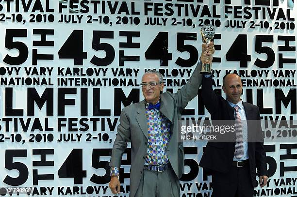Spanish film director August Vila and Spanish film producer Luis MInarro pose with their Crystal Globe Awards for best film at the 45th Karlovy Vary...