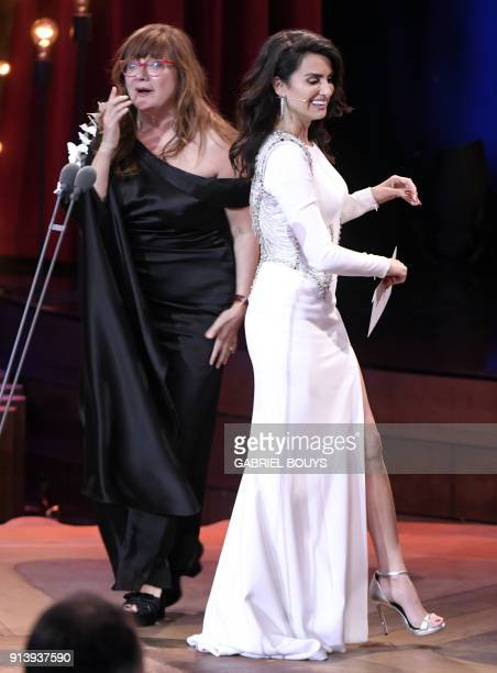 Spanish film director Isabel Coixet gestures beside Spanish actress Penelope Cruz after receiving the best film and best direction awards for 'La...