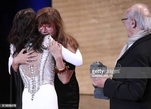 Spanish film director Isabel Coixet is congratulated by Spanish actress Penelope Cruz beside Spanish director Carlos Saura after receiving the best...