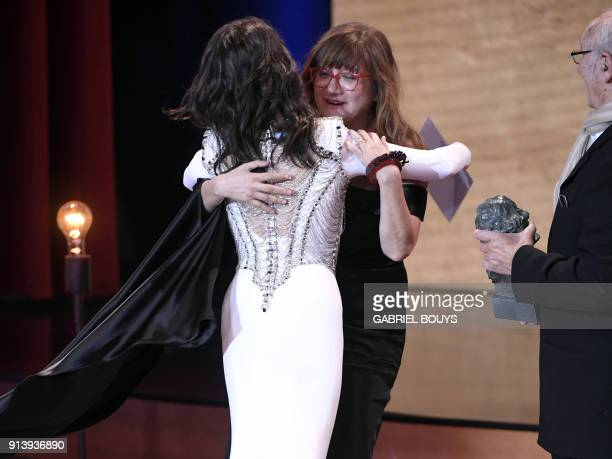 Spanish film director Isabel Coixet receives the best film award for 'La Libreria' from Spanish actress Penelope Cruz at the 32nd Goya awards...