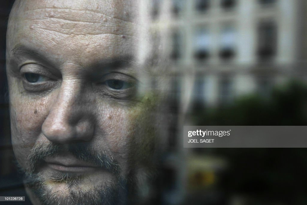 Spanish film director Juan Jose Campanella, Argentinian-born, is seen behind a window as he poses on May 3, 2010 at his hotel in Paris. Campanella was awarded with the Oscar for the Best Foreign Film of the Year for 'El Secreto de Sus Ojos' (The Secret of Her Eyes) on March 7 in Hollywood. The movie will be realeased in France on May 5.