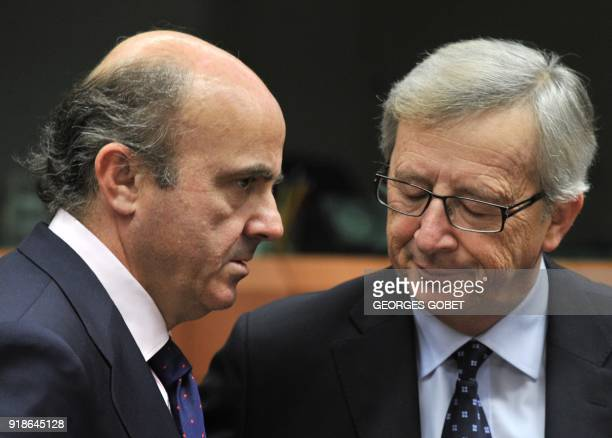 Spanish Finance Minister Luis De Guindos and Luxembourg Prime Minister and Eurogroup president JeanClaude Juncker talk prior to an Eurozone meeting...