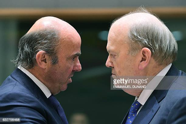 Spanish Finance Minister Luis de Guindos Jurado and Ireland's Finance Minister Michael Noonan attend an Eurogroup finance ministers meeting at the...